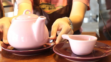 Barista Serving Hot Tea With Ceramic Pot, Stock Video