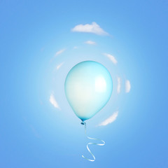 Blue balloon flying