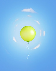 Green balloon flying