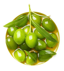 Green olives with leaves in oil
