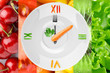 Food clock with vegetables and fruits