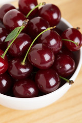Sweet ripe cherry in bowl closeup