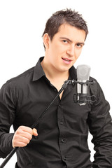 Elegant male singer holding a microphone