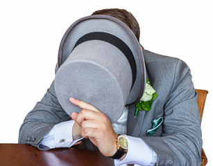 Gentleman hiding his face underneath a top hat