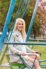 Pregnant woman sitting swing