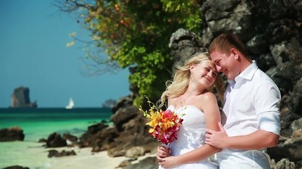 Beautiful Wedding couple on the islands with blue water