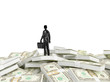 Tiny person standing on a huge pile of money