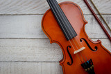 Fototapety Old Classic violin vintage on the wooden background