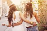 Boho girls walking in the city poster