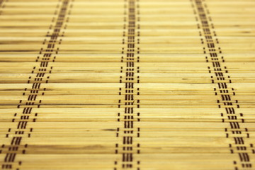 Table mat made out of bamboo pieces.
