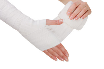 Hand bandaging by elastic bandage. Closeup. isolated