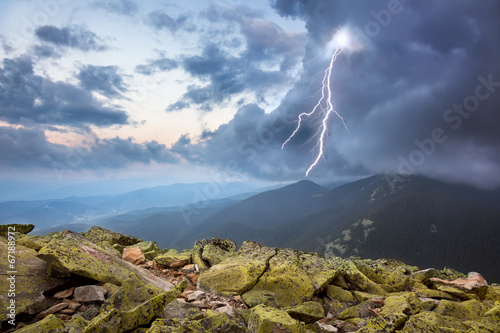 thunderstorm with lightening and dramatic clouds in mountains - 67188972
