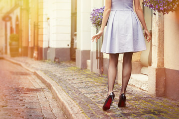 Romantic photo of woman walking in old town