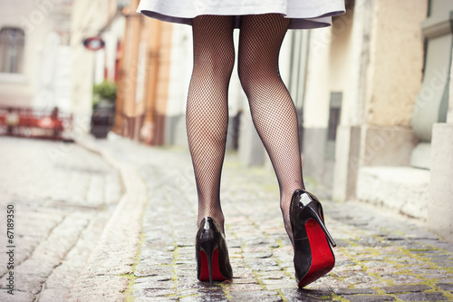 canvas print picture Sexy legs in black high heel shoes