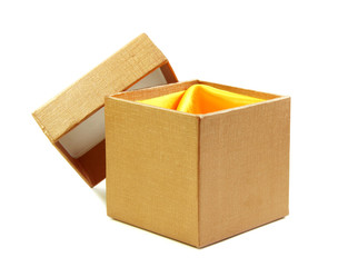 Gold box and lid line with yellow cloth