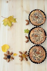 Autumn still life of nut pastries and autumn leaves .