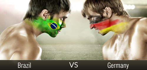Two soccer fans with flags face to face