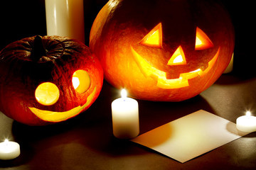 Halloween pumkins, candles and postcard