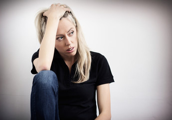 Young unhappy woman in depression