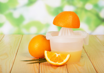 Citrus juicer with orange on the table