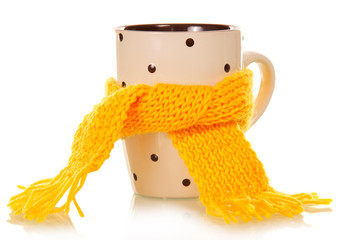 Teacup tied with a yellow scarf