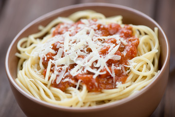 Close-up of spaghetti with bolognese sauce and parmesan