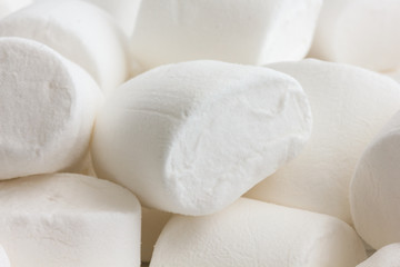 Detail white marshmallows. Randomly arranged.