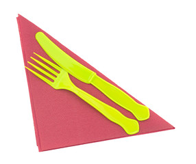 Bright green plastic knife and fork on red serviette, napkin.