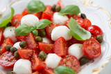 Caprese salad with capers, studio shot, close-up