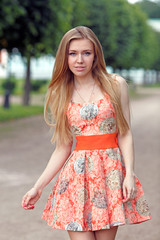 Beautiful blonde girl standing in the Park
