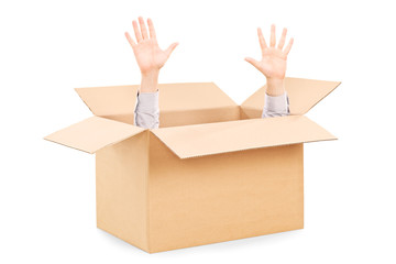 Hands arising from a carton box symbolizing surrender