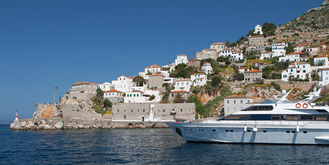 Hydra island with yacht in the foreground