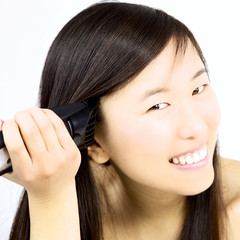 Happy asian girl shaving head