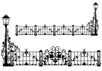 beautiful iron fence with street light and gates