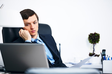 Office worker talking on cell phone in office