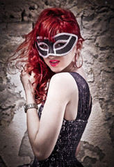 Masquerade. Beautiful girl in a carnival mask.