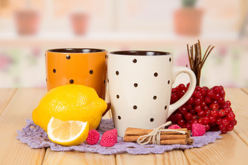Two cups of tea with lemon, cranberry
