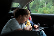 Boys in the car using a touchpad - 67194700