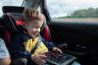 Happy boy playing with touchpad in the car - 67194709