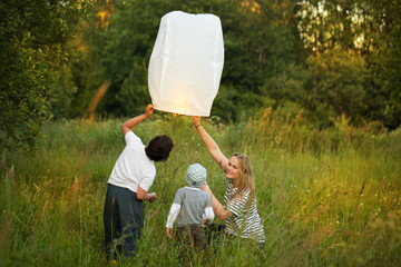 Mother with her sons flying paper lantern