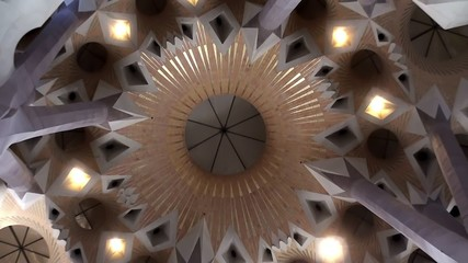 Inside of the Sagrada Familia church. Ceiling with columns