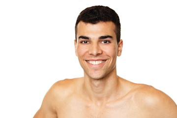 Portrait of young smiling man shirtless