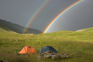 double rainbow at campsite