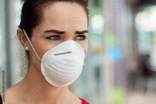 Woman wearing mask in city.