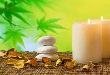 Spa massage border background with candle near stone and wood