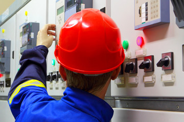 Worker in a helmet, the electrician