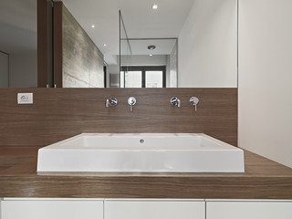 washbasin on the wood furniture in a modern bathroom