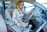 attractive blond woman in driver seat