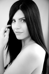 Beautiful female model with long black hair smiling