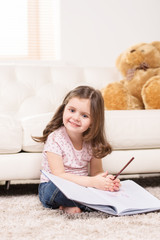 charming little girl writing in notebook.